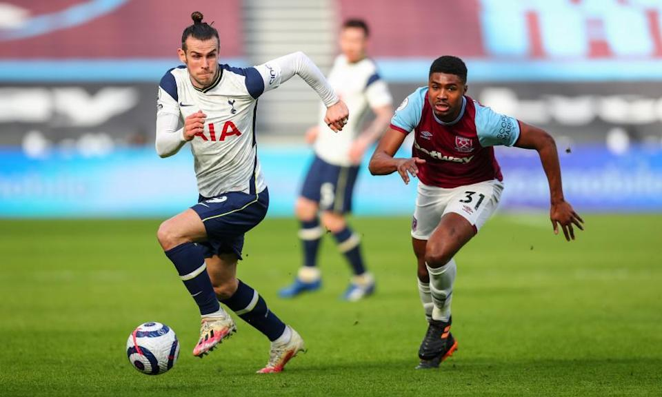 Gareth Bale takes on West Ham's Ben Johnson at the London Stadium, where the Spurs forward showed flashes of his old form.