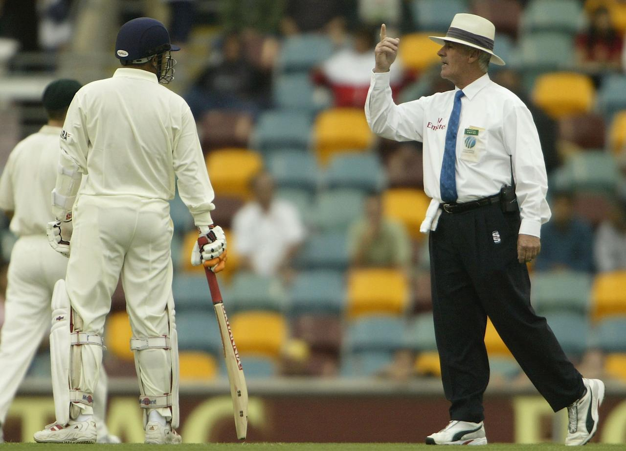 BRISBANE,  AUSTRALIA  - DECEMBER 6: Umpire Rudi Koertzen discusses the rainy conditions with Akash Choppra of India on day three of the first test between Australia and India played at the Gabba, December 6, 2003 in Brisbane, Australia (Photo by Chris McGrath/Getty Images)