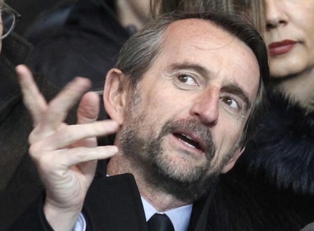 FILE - In this file photo dated Friday, Feb. 14, 2014, Paris Saint Germain's Jean-Claude Blanc, prior to the French League one soccer match between Paris Saint Germain and Valenciennes, at the Parc des Princes stadium, in Paris. PSG's deputy chief executive officer Jean-Claude Blanc spoke of his outrage Thursday Nov. 8, 2018, and pledged an investigation into some club scouts who secretly and illegally profiled potential young recruits from outside the Paris region with lists containing their ethnic origins.(AP Photo/Thibault Camus, FILE)