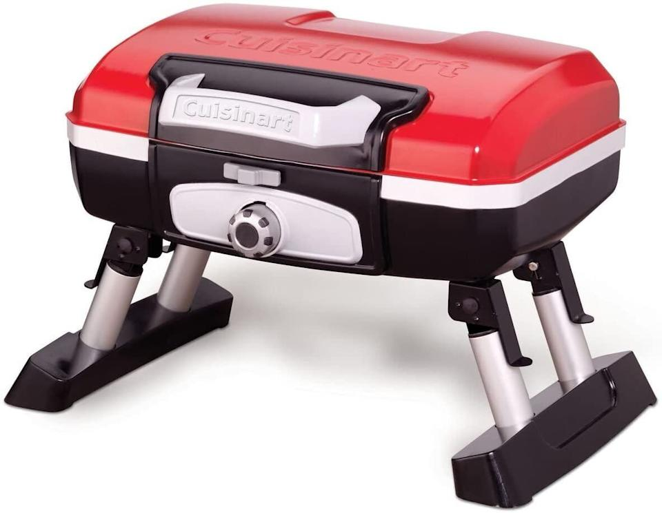 "If you're in a small space, this gas grill can just go on top of a table. It has foldaway legs and carrying handle. Plus, this grill can cook anything from burgers to fish. <a href=""https://amzn.to/2Vv6SsY"" rel=""nofollow noopener"" target=""_blank"" data-ylk=""slk:Find it for $140 at Amazon"" class=""link rapid-noclick-resp"">Find it for $140 at Amazon</a>."