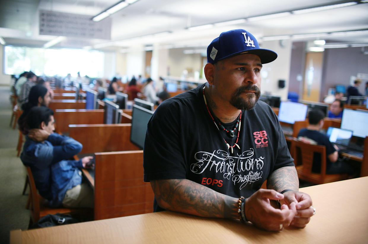 "Leyva, who has spent years in prison, is on track to get a master's degree in sociology this spring from California State University San Marcos. He credits education with turning his life around: ""We don't let our past crimes define our progress moving forward in life."" (Photo: Sandy Huffaker for Yahoo News)"
