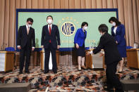 Candidates for the presidential election of the ruling Liberal Democratic Party prepare for a group photo, prior to a debate session held by Japan National Press club Saturday, Sept. 18, 2021 in Tokyo. The contenders are from left to right, Taro Kono, the cabinet minister in charge of vaccinations, Fumio Kishida, former foreign minister, Sanae Takaichi, former internal affairs minister, and Seiko Noda, former internal affairs minister. (AP Photo/Eugene Hoshiko, Pool)