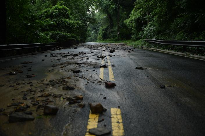Flood debris from the rain storm is seen on Canal Road on July 8, 2019 in Washington, D.C. (Photo: Brendan Smialowski/AFP/Getty Images)