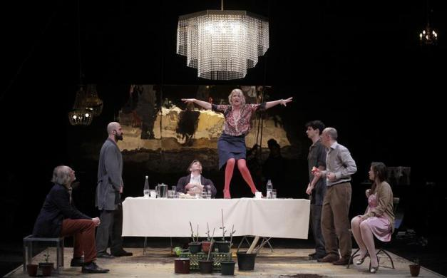 Actors Guenter Franzmeier (L) Simon Mantei (centre L) Heike Kretschmer (centre R) Patrick O. Beck (2nd R) and Nanette Waidmann (R) perform on stage during a dress rehearsal of Maxim Gorky's 'Kinder der Sonne' (Children of the Sun) at Volkstheater in Vienna, April 24, 2012.