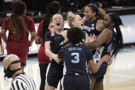 North Carolina players celebrate following a victory over North Carolina State in an NCAA college basketball game in Chapel Hill, N.C., Sunday, Feb. 7, 2021. (AP Photo/Gerry Broome)