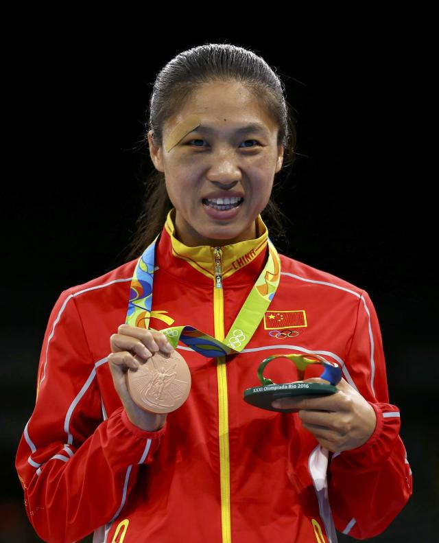 2016 Rio Olympics - Boxing - Victory Ceremony - Women's Fly (51kg) Victory Ceremony - Riocentro - Pavilion 6 - Rio de Janeiro, Brazil - 20/08/2016. Bronze medallist Ren Cancan (CHN) of China poses with her medal. REUTERS/Peter Cziborra FOR EDITORIAL USE ONLY. NOT FOR SALE FOR MARKETING OR ADVERTISING CAMPAIGNS.