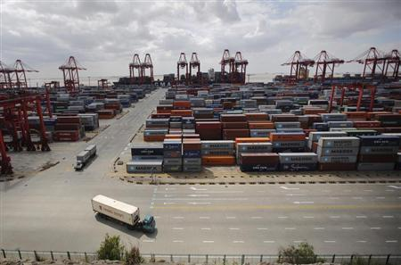 Container trucks drive past the container area at the Yangshan Deep Water Port, part of the newly announced Shanghai Free Trade Zone, south of Shanghai