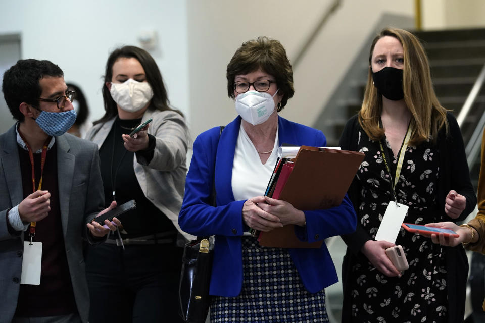 Sen. Susan Collins, R-Maine, is followed by reporters as she walks on Capitol Hill in Washington, Thursday, Feb. 11, 2021, after the third day of the second impeachment trial of former President Donald Trump. (AP Photo/Susan Walsh)