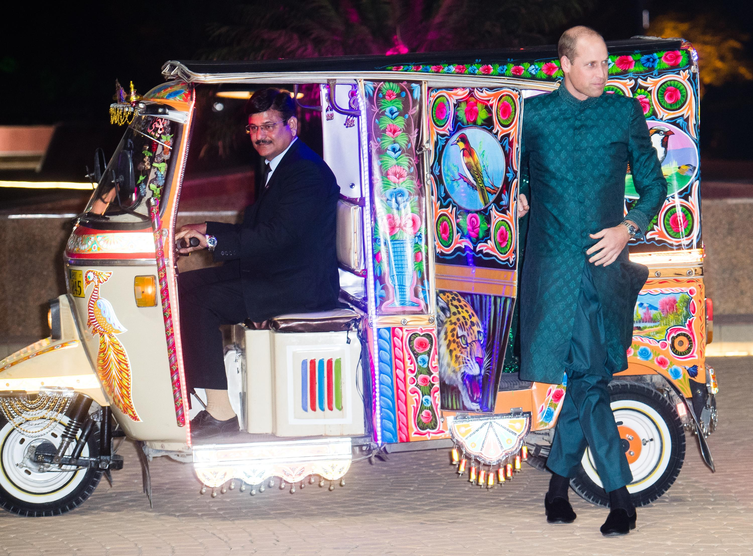 ISLAMABAD, PAKISTAN - OCTOBER 15: Catherine, Duchess of Cambridge and Prince William, Duke of Cambridge arrive by Tuk Tuk as they attend a special reception hosted by the British High Commissioner Thomas Drew, at the Pakistan National Monument, during day two of their royal tour of Pakistan on October 15, 2019 in Islamabad, Pakistan. (Photo by Samir Hussein/WireImage)
