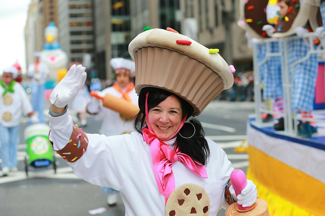 A performer dressed as a cookie with the Deck the Halls Float smiles while entertaining the crowd along the parade route in the 93rd Macy's Thanksgiving Day Parade in New York. (Photo: Gordon Donovan/Yahoo News)