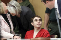 FILE - In this Jan. 22, 2020, file photo, Florida school shooting defendant Nikolas Cruz is surrounded by his defense attorneys Melisa McNeill, left, Diane Cuddihy and Gabe Ermine, right, after entering the courtroom for a hearing at the Broward County Courthouse in Fort Lauderdale, Fla. It's been more than 1,000 days since a gunman with an AR-15 rifle burst into a Florida high school, killing 17 people and wounding 17 others. And yet, with Valentine's Day on Sunday, Feb. 14, 2021, marking the three-year milestone, Cruz's death penalty trial is in limbo. (Amy Beth Bennett/South Florida Sun-Sentinel via AP, Pool, File)