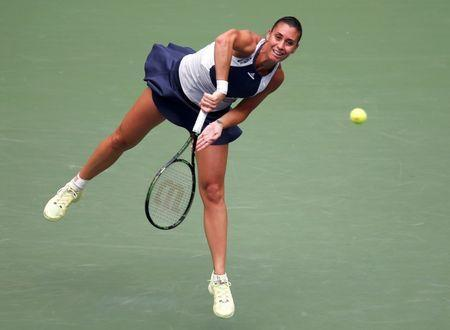 Flavia Pennetta of Italy serves to Simona Halep of Romania during their women's singles semi-final match at the U.S. Open Championships tennis tournament in New York, September 11, 2015. REUTERS/Carlo Allegri Picture Supplied by Action Images