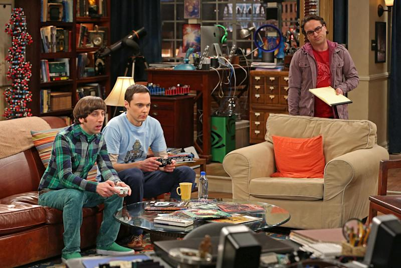"""This undated publicity image released by CBS shows, from left, Simon Helberg, Jim Parsons, and Johnny Galecki in a scene from """"The Big Bang Theory,"""" a long-running series, one of 18 shows renewed by CBS on Wednesday, March 27, 2013. (AP Photo/CBS, Michael Yarish)"""