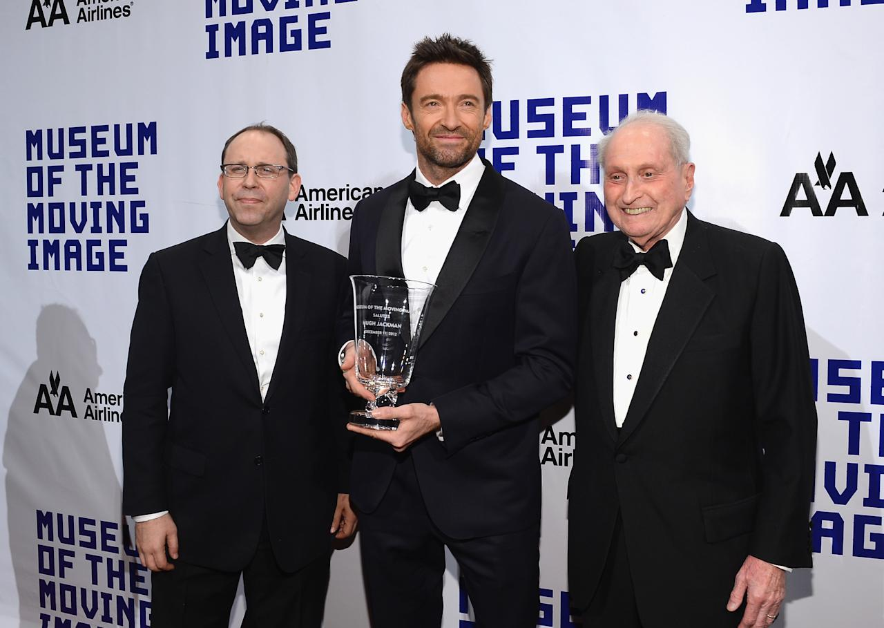 NEW YORK, NY - DECEMBER 11:  Actor Hugh Jackman poses with MMI Director Carl Goodman  (L) and  MMI Board Chairman television executive Herbert S. Schlosser and his award at the Museum of Moving Images salute to Hugh Jackman at Cipriani Wall Street on December 11, 2012 in New York City.  (Photo by Larry Busacca/Getty Images)
