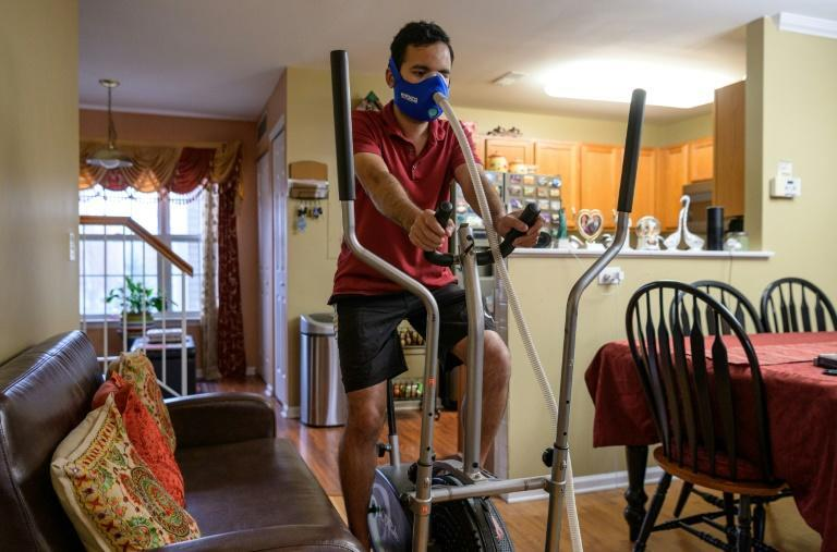 Akash Negi trains with a face masks attached to a device that reduces his oxygen supply