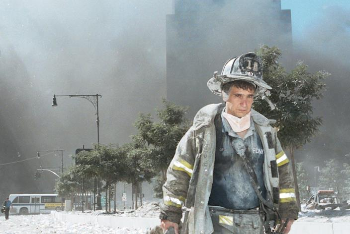 """<span class=""""caption"""">Toxic dust hung in the air around ground zero for more than three months following the 9/11 terrorist attacks.</span> <span class=""""attribution""""><a class=""""link rapid-noclick-resp"""" href=""""https://www.gettyimages.com/detail/news-photo/an-unidentified-new-york-city-firefighter-walks-away-from-news-photo/1372804?adppopup=true"""" rel=""""nofollow noopener"""" target=""""_blank"""" data-ylk=""""slk:Anthony Correia/Getty Images"""">Anthony Correia/Getty Images</a></span>"""