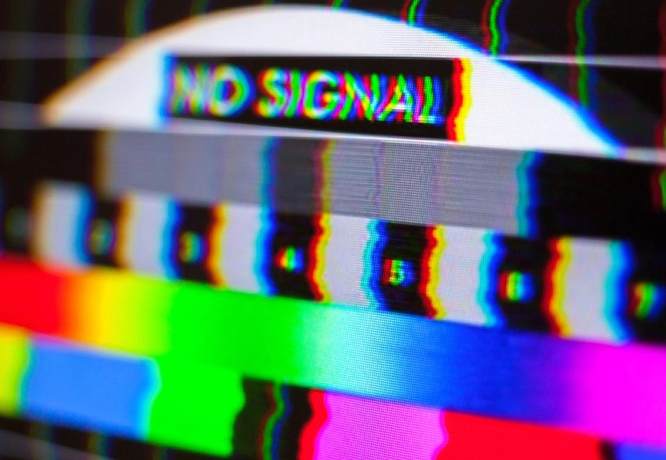 close up of no signal and color bars on a tv screen