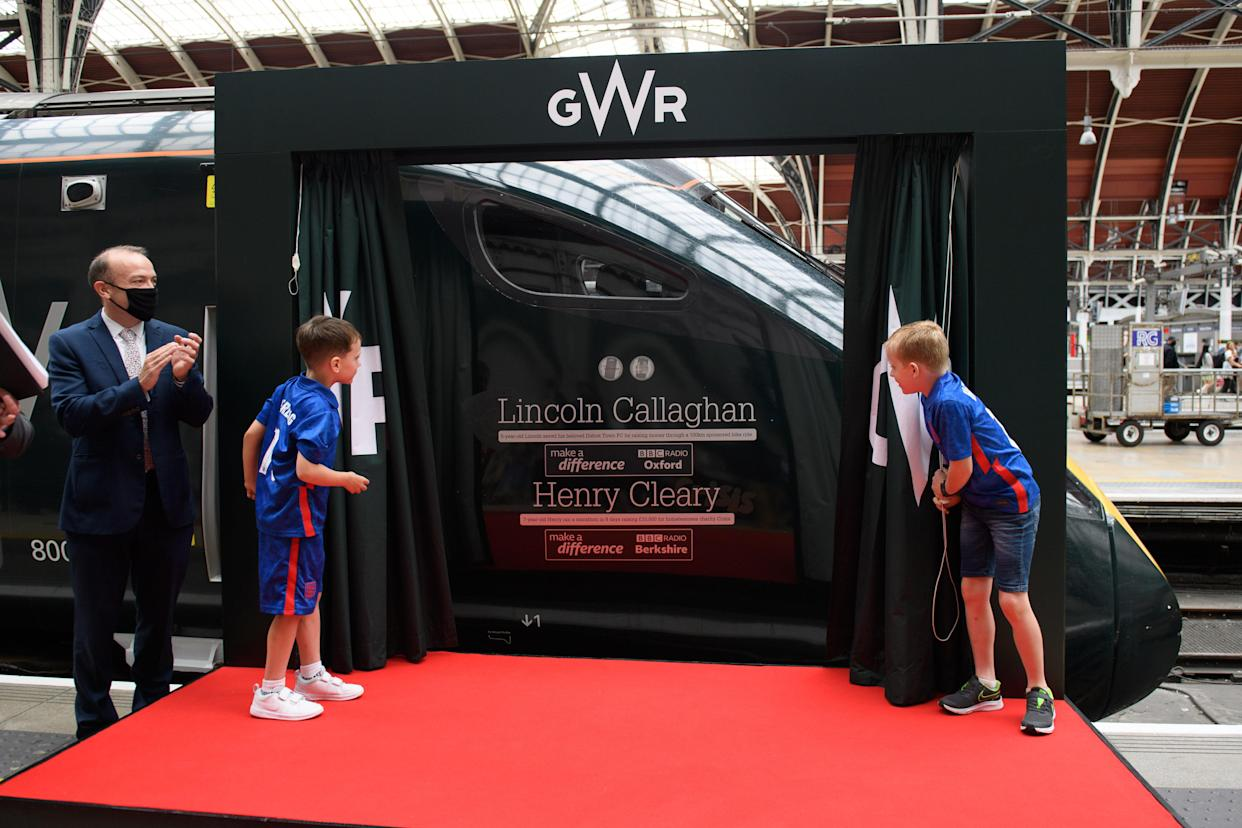Lincoln Callaghan (left) and Henry Cleary the duo have become youngest ever to have train named in their honour. Two mini-marvels are to become the youngest ever to have their names on the side of a train as Great Western Railway celebrates their fundraising heroics. Didcot Town superfan Lincoln Callaghan and young marathon runner Henry Cleary were chosen as BBC Make a Difference Superstars for selflessly helping others at the peak of the Covid-19 pandemic.