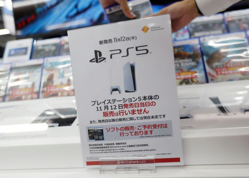 A sign announcing that the new Sony PlayStation 5 gaming console will not be sold by over-the-counter sales on the launch day is displayed in Tokyo