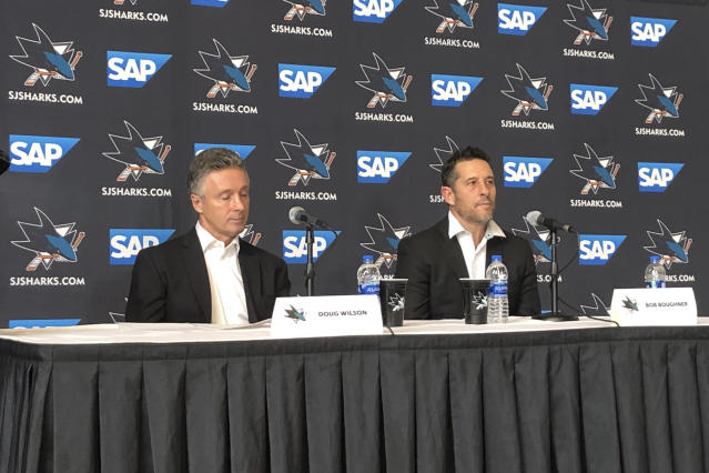 San Jose Sharks general manager Doug Wilson, left, and interim coach Bob Boughner listen to questions during a news conference Thursday, Dec. 12, 2019, in San Jose, Calif. The San Jose Sharks play their first game under interim coach Bob Boughner when they host the New York Rangers. Peter DeBoer was fired with the team on a five-game losing streak. He led the Sharks to their first Stanley Cup Final in his first season in 2016. (AP Photo/Josh Dubow)