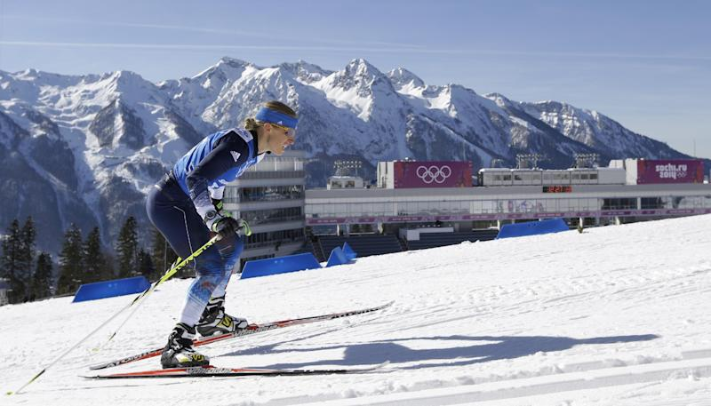 Lanny Barnes of the United States skis during a biathlon training session at the 2014 Winter Olympics, Friday, Feb. 7, 2014, in Krasnaya Polyana, Russia. (AP Photo/Kirsty Wigglesworth)