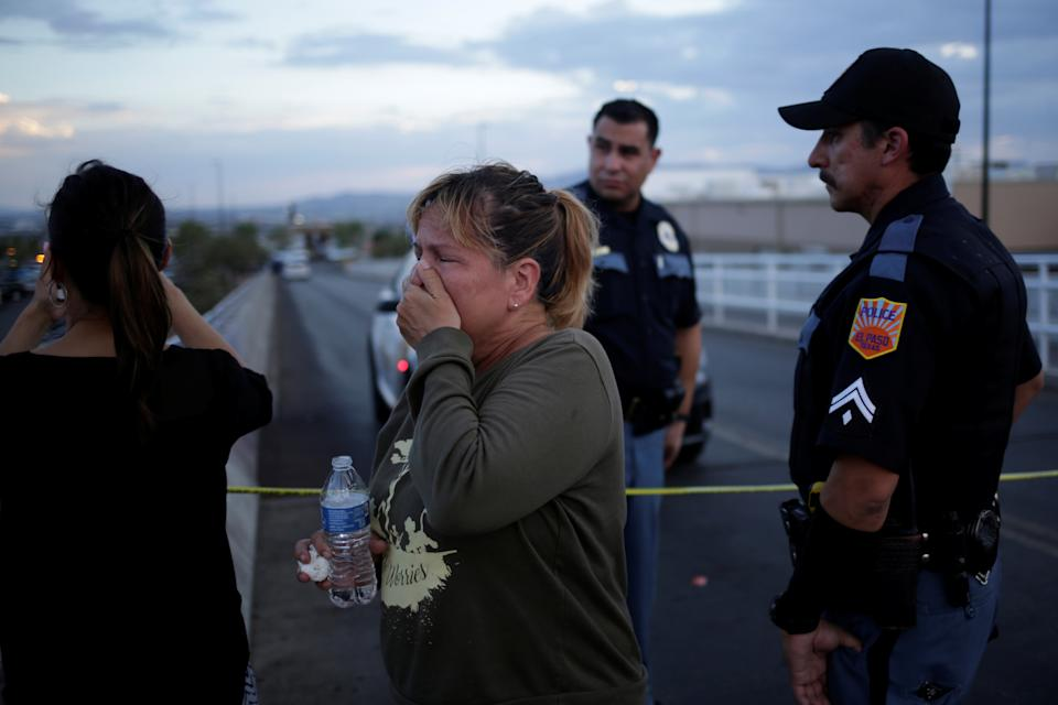 A woman reacts after a mass shooting at a Walmart in El Paso, Texas, U.S. August 3, 2019. REUTERS/Jose Luis Gonzalez