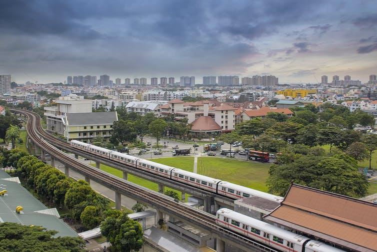 A view of Singapore's skyline with a mass rapid transit station in the foreground.