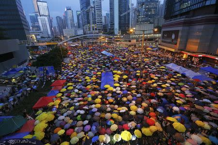 File photo of protesters opening umbrellas as they mark exactly one month since they took the streets in Hong Kong's financial central district