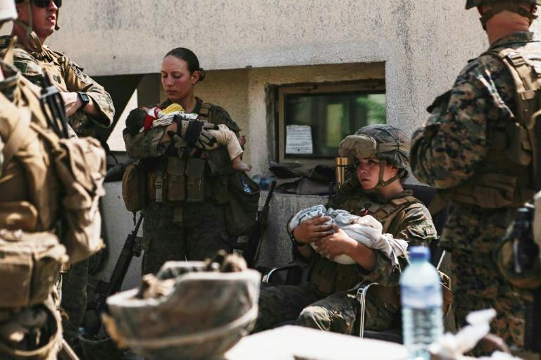 US Marines assigned to the 24th Marine Expeditionary Unit calmed infants at Kabul's airport in images distributed by the military