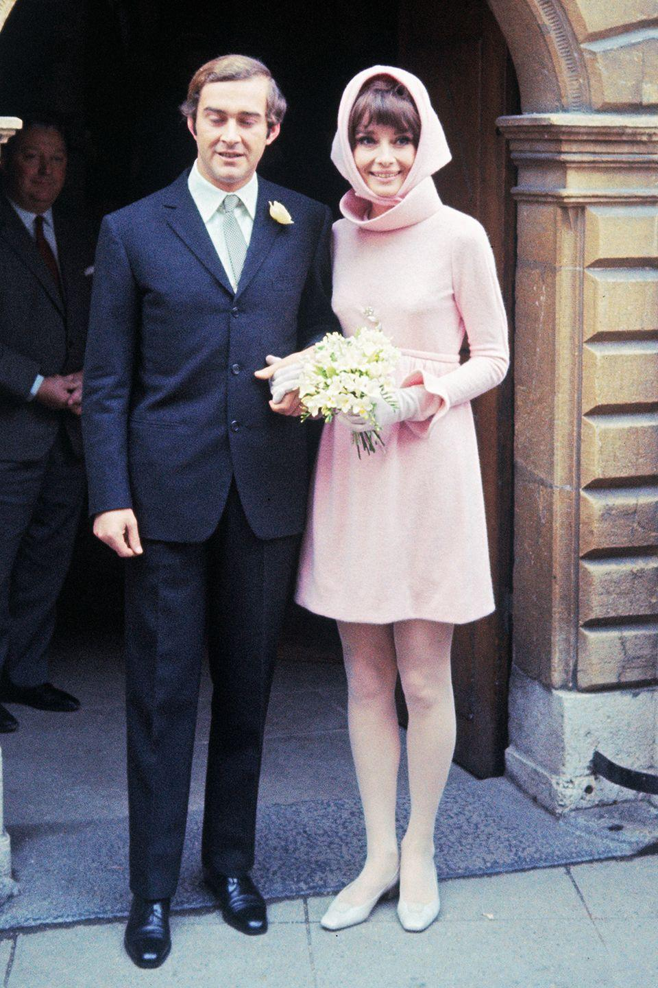 """<p>The high-collared wedding dress Audrey wore to wed her second husband, psychiatrist Andrea Dotti, in Morges, Switzerland, captured her signature simple style.</p><p><strong>RELATED</strong>: <a href=""""https://www.goodhousekeeping.com/life/relationships/a44710/audrey-hepburn-love-life-timeline/"""" rel=""""nofollow noopener"""" target=""""_blank"""" data-ylk=""""slk:A Timeline of Audrey Hepburn's Hollywood Love Stories"""" class=""""link rapid-noclick-resp"""">A Timeline of Audrey Hepburn's Hollywood Love Stories</a></p>"""