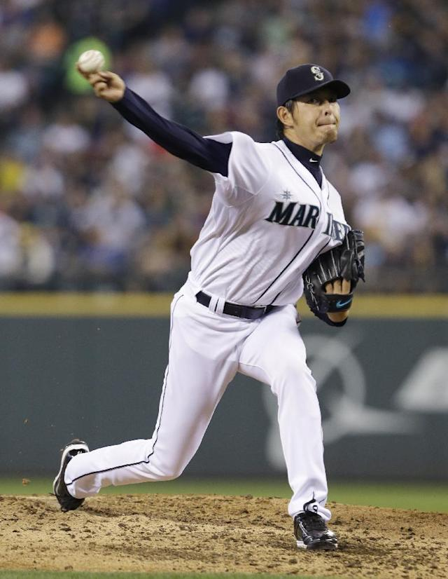 Seattle Mariners starting pitcher Hisashi Iwakuma throws to a Milwaukee Brewers batter in the fifth inning of a baseball game Saturday, Aug. 10, 2013, in Seattle. (AP Photo/Elaine Thompson)