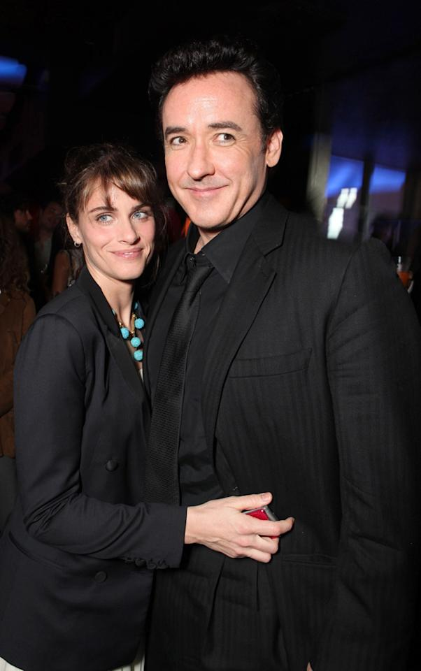 """<a href=""""http://movies.yahoo.com/movie/contributor/1800018738"""">Amanda Peet</a> and <a href=""""http://movies.yahoo.com/movie/contributor/1800019276"""">John Cusack</a> at the Los Angeles premiere of <a href=""""http://movies.yahoo.com/movie/1810045661/info"""">2012</a> - 11/03/2009"""