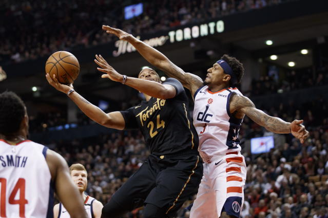 Toronto Raptors guard Norman Powell (24) shoots as Washington Wizards guard Bradley Beal (3) defends during the first half of an NBA basketball game Friday, Jan. 17, 2020, in Toronto. (Cole Burston/The Canadian Press via AP)