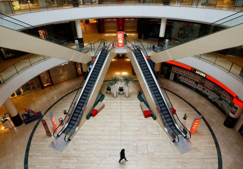FILE PHOTO: A person is seen inside an empty shopping mall during a partial lockdown in Leverkusen
