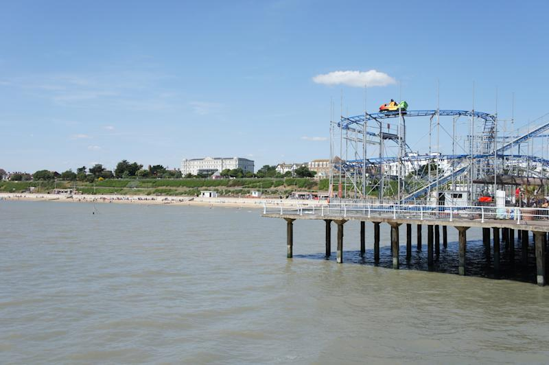 Clacton-on-Sea Pier with roller coaster and beach in the background.