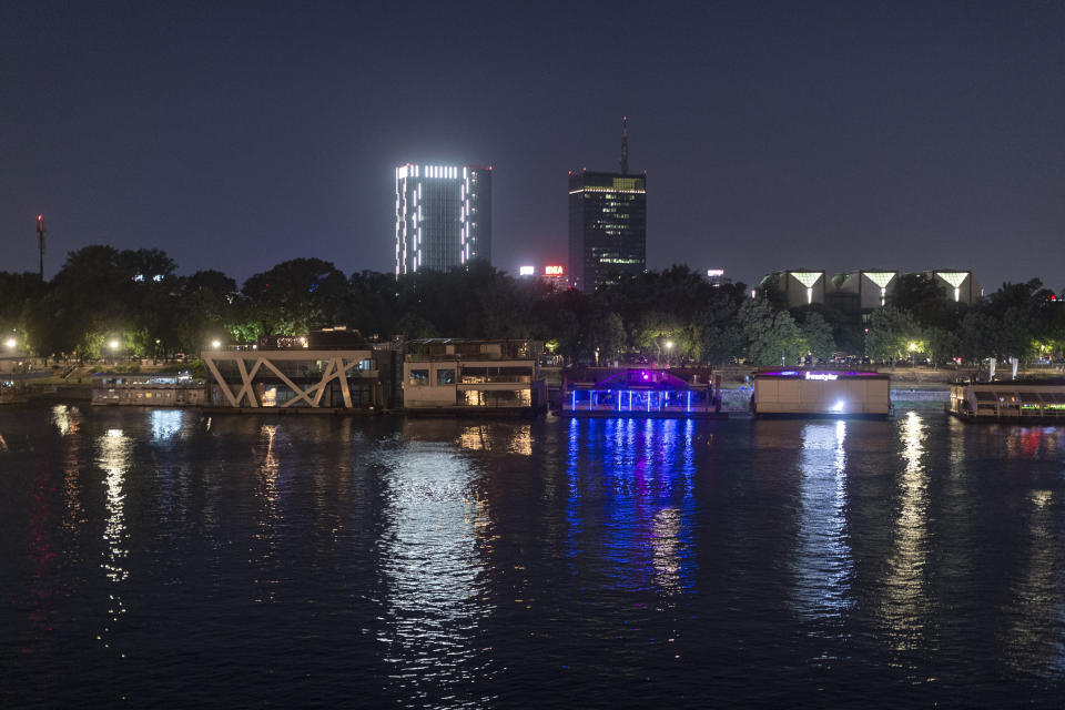 In this photo taken on Saturday, July 10, 2021, a row of river rafts and night clubs are seen on the Sava river waterfront in central Belgrade, Serbia. Serbia's capital is vibrating with nightlife again after over a year of pandemic restrictions. Cafes, bars and fun-hungry customers are celebrating a summer boom in business and entertainment options. But the accompanying loud music and noise are a bust for residents across Belgrade. (AP Photo/Marko Drobnjakovic)