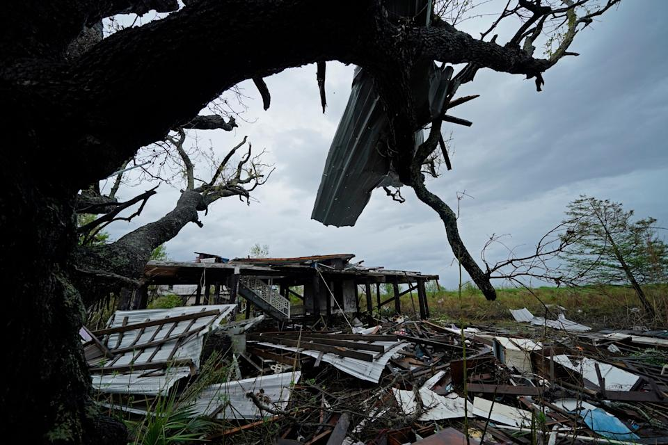 Storm clouds from Tropical Storm Nicholas are seen behind homes of the vanishing Native American community of Isle de Jean Charles, La., which were destroyed by Hurricane Ida on Sept. 14, 2021.