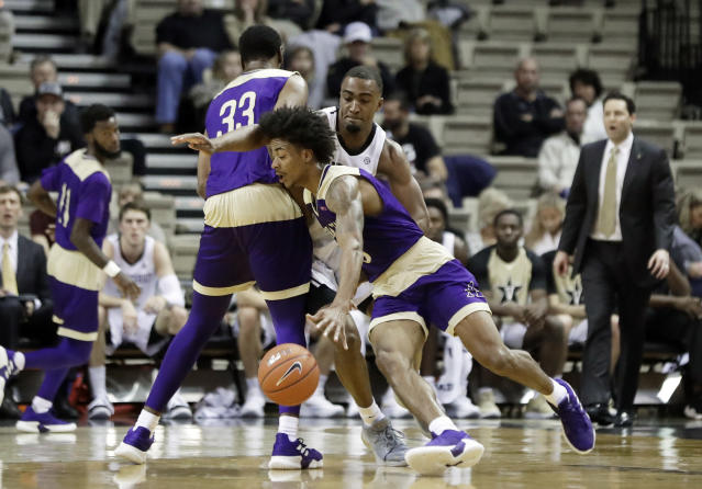 Alcorn State guard Troymain Crosby, front, gets past Vanderbilt guard Joe Toye, right, as Devon Brewer (33) sets a pick in the first half of an NCAA college basketball game Friday, Nov. 16, 2018, in Nashville, Tenn. (AP Photo/Mark Humphrey)