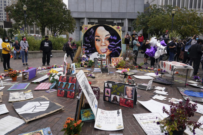 FILE - In this Sept. 23, 2020, file photo, people gather in Jefferson Square awaiting word on charges against police officers, Wednesday, Sept. 23, 2020, in Louisville, Ky. Hours of material in the grand jury proceedings for Taylor's fatal shooting by police have been made public on Friday, Oct. 2. (AP Photo/Darron Cummings)