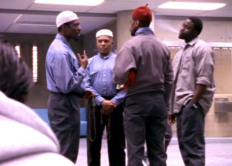 Eamonn Walker talking to his Muslim brothers. (Credit: HBO)