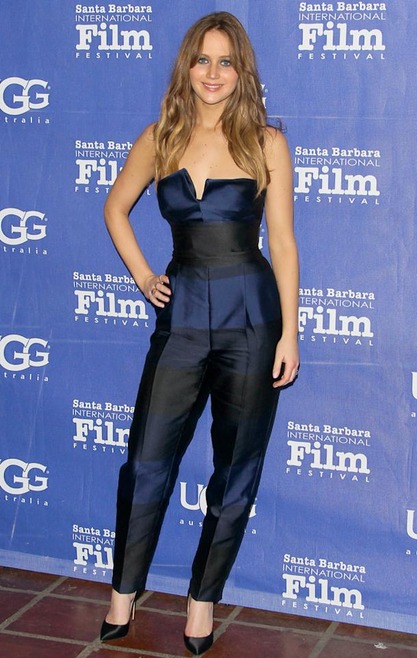 Jumpsuits, love 'em or hate 'em? We've always been on the fence and always will be. That said, we're kinda feeling this Stella McCartney ensemble Jennifer Lawrence recently wore to the 28th Santa Barbara Film Festival. Surprisingly, we also like the lack of accessories. All she needed were those basic black Casadei pumps. (2/2/2013)