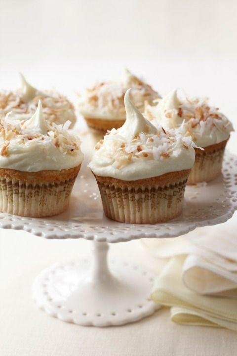 """<p>The great thing about coconut is its versatility; it feels refreshing in warm weather and comforting in cold. This recipe makes the most of it, featuring a triple whammy of coconut in the batter—flakes, extract and milk—and a coconut cream cheese frosting.</p><p><strong><a href=""""https://www.womansday.com/food-recipes/food-drinks/recipes/a11194/coconut-cupcakes-coconut-white-chocolate-frosting-recipe-122600/"""" rel=""""nofollow noopener"""" target=""""_blank"""" data-ylk=""""slk:Get the recipe."""" class=""""link rapid-noclick-resp"""">Get the recipe.</a></strong></p>"""