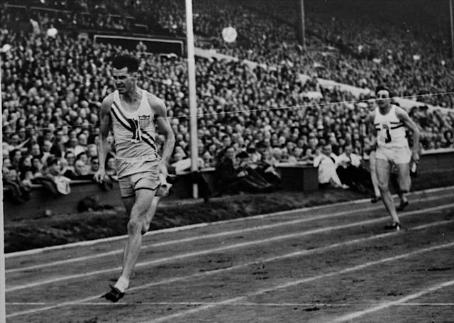 Mel Patton, left, anchor man of the U.S. men's 4 x 100-meter relay team, crosses the finish line well ahead of Britain's Jack Archer, during the Summer Olympics at Wembley Stadium, in London Aug. 7, 1948. Olympic judges disqualified the U.S. team on the grounds that their first exchange of the baton was not made within the 20-meter zone, but reversed their decision three days later giving the U.S. the gold medal and Britain the silver.(AP Photo)