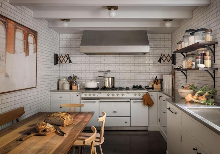 In one kitchen, wall tiles with a custom color blend were sourced by Pratt & Larson Portland Bisque.The encaustic floor tiles are from Clé, and the Saulieu range is by Lacanche.