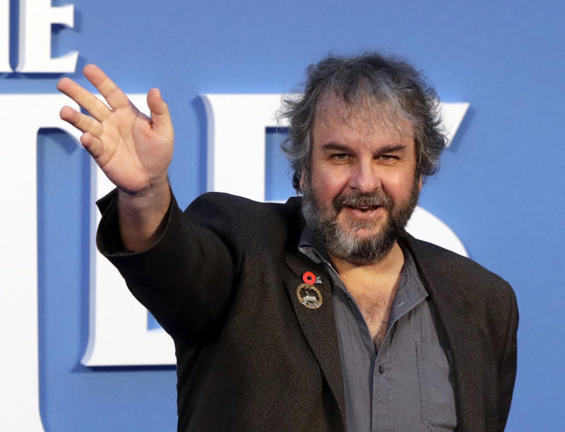 """FILE - In this file photo dated Thursday, Sept. 15, 2016, film director Peter Jackson poses for photographers at the World premiere of the Beatles movie, in London. According to an announcement Tuesday Aug. 21, 2018, Jackson's new film """"They Shall Not Grow Old""""  a documentary that transforms grainy footage from World War I into color, will have its world premiere at the London Film Festival in October. (AP Photo/Kirsty Wigglesworth, FILE)"""