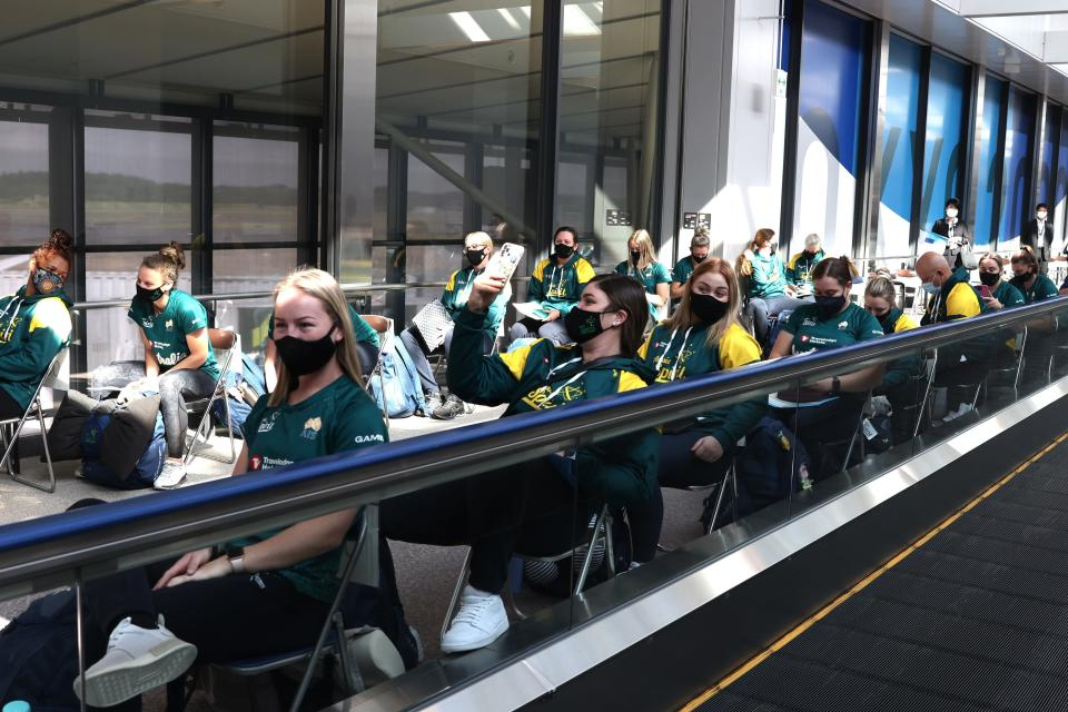 Australian softball national team players wait for the antigen test after arriving at the Narita International Airport in Narita, Chiba, east of Tokyo, Tuesday, June 1, 2021. The Australian team is one of the first teams to arrive ahead of the Tokyo 2020 Olympic games, scheduled to open July 23. (Behrouz Mehri/Pool Photo via AP)