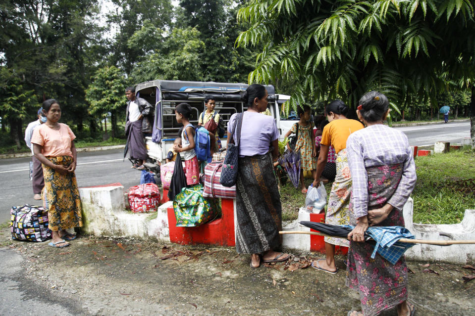 Ethnic Rakhine villagers gather on the street as they arrive at a temporary monastery camp, Monday, June 29, 2020, in Sittwe, Rakhine State, Myanmar. Thousands of people in an area of western Myanmar where there have been clashes between the government and ethnic rebels have been fleeing from their villages after an evacuation order from officials, despite being revoked several days ago. (AP Photo)