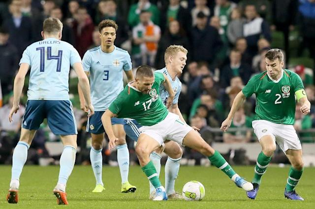 Republic of Ireland's Conor Hourihane battles for the ball against rivals Northern Ireland (AFP Photo/Paul FAITH)