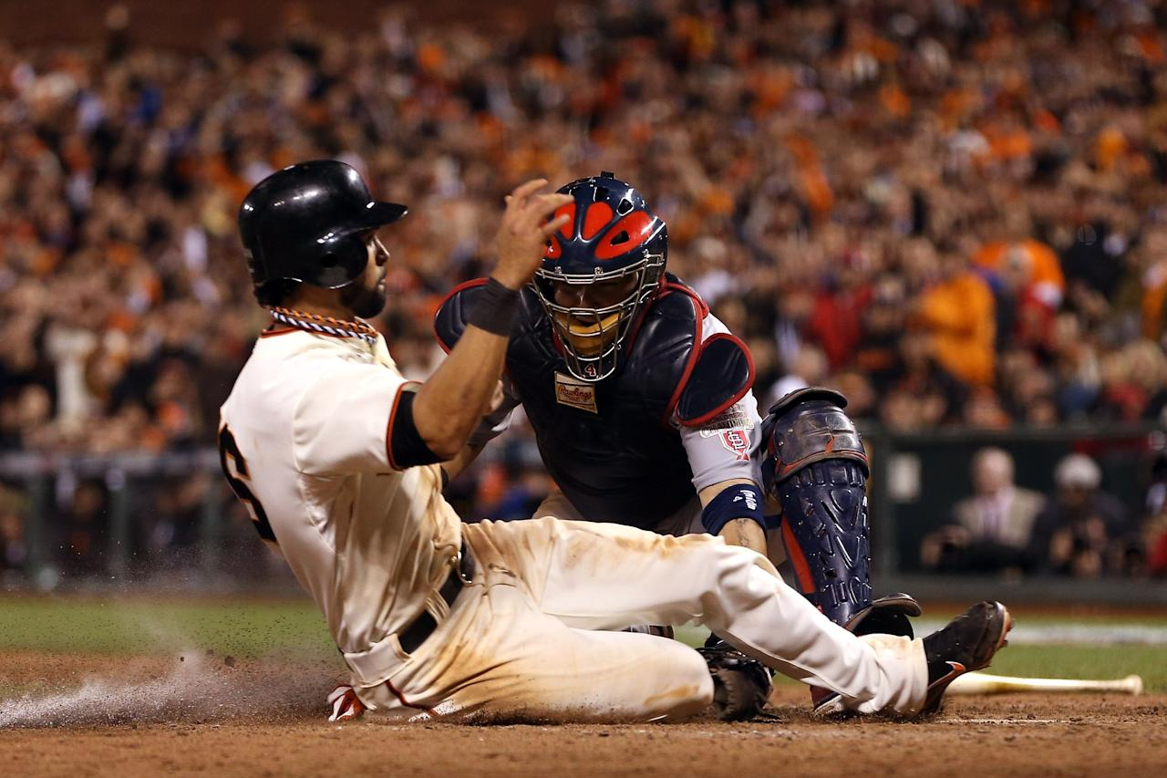 SAN FRANCISCO, CA - OCTOBER 22:  Angel Pagan #16 of the San Francisco Giants is tagged out by catcher Yadier Molina #4 of the St. Louis Cardinals in the seventh inning in Game Seven of the National League Championship Series at AT&T Park on October 22, 2012 in San Francisco, California.  (Photo by Ezra Shaw/Getty Images)