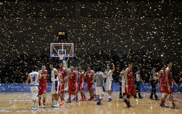 28th SEA Games Singapore 2015 - OCBC Arena Hall 1 - Singapore - 15/6/15 Basketball - Men's Gold Medal Game - Indonesia v Philippines - Confetti falls on the court as Philippines celebrates winning the gold medal SEAGAMES28 Mandatory Credit: Singapore SEA Games Organising Committee / Action Images via Reuters